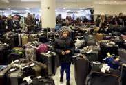 IMAGES: Hobbled by a Storm, Then Deluged by a Tide of Incoming Flights