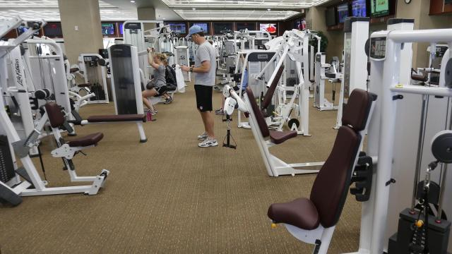 """FILE-- A Life Time gym in Vestavia Hills, Ala., April 12, 2013. The chain, which has 130 locations, will no longer show cable-news channels on its large-screen TVs starting in early 2018 – , citing member requests and """"our overall healthy way of life philosophy."""" (Gary Tramontina/The New York Times)"""