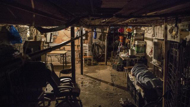 A homeless man sleeps in the basement of a bodega in Brooklyn whose owner has long given shelter to the down-and-out, Dec. 26, 2017. Despite the crude conditions, the men say the basement harbors a resource even scarcer for them: kindness. (Victor J. Blue/The New York Times)