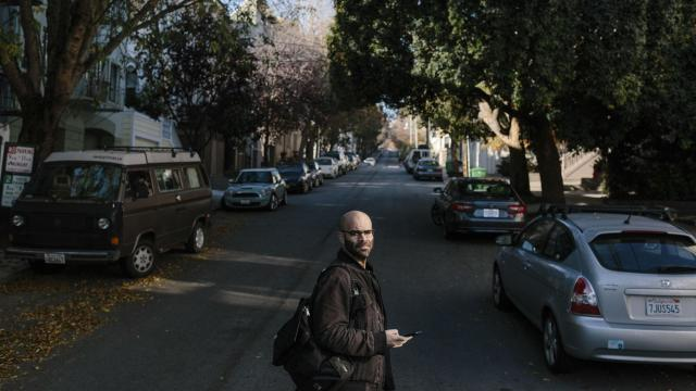 "Mike Isaac, a technology reporter for The New York Times, in San Francisco, Dec. 14, 2017. Isaac, whose beat often sees him reporting on Uber and Lyft, does not own a car but prefers to use public transit or an app called Getaround — ""essentially an Airbnb for people's cars,"" as Isaac put it. (Jason Henry/The New York Times)"