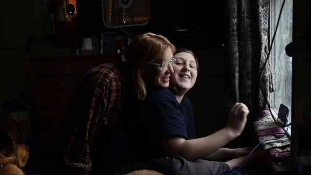 Rebecca Ribeiro with her son, Max, 12, at home in Newfield, N.Y., Jan. 6, 2018. With Congress yet to agree on a long-term plan to pay for the popular Children's Health Insurance Program, better known as CHIP, parents have started thinking about contingency plans. CHIP covers Max, who has a learning disorder. (Heather Ainsworth/The New York Times)