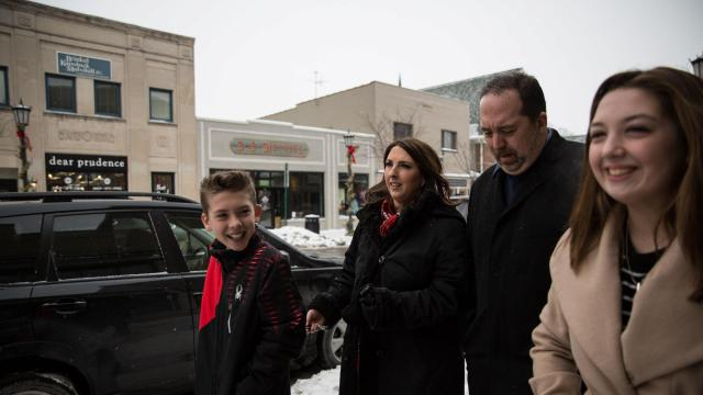 """Ronna McDaniel, the chairwoman of the Republican National Committee, with her husband, Patrick, and their two children, Nash, 12, and Abigail, 14, in Northville, Mich., Jan. 3, 2018. Tasked with fortifying a party in a hostile election environment, McDaniel has been highly deferential to President Donald Trump, and even stopped using her full name — Ronna Romney McDaniel. """"You know the job you're signing up for,"""" she said. (Ali Lapetina/The New York Times)"""