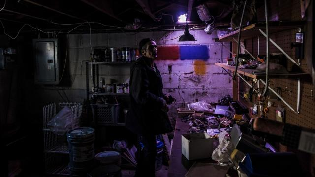 JC Marin in his basement amid the remnants of his time working as a handyman in New York, Dec. 13, 2017. Addicted to heroin, Marin and his wife, Melissa Neilson, take a taxi to a clinic to receive a dose of methadone six days a week, a ride of more than two hours each way paid for by Medicaid. (Ryan Christopher Jones/The New York Times)