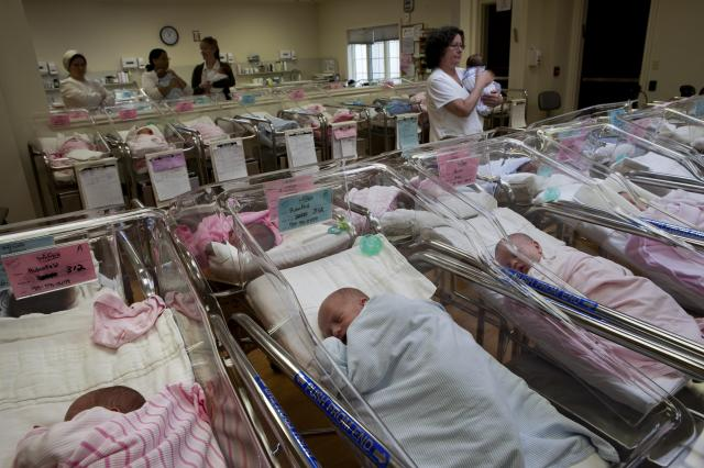FILE -- Infants at a private center for new mothers recuperating from childbirth, in Monroe, N.Y., April 4, 2011. Having a daughter versus a son used to make American parents more likely to keep having children, theoretically to try for a son -- but a new study shows that having a daughter now makes parents less likely to keep having children. (Richard Perry/The New York Times)