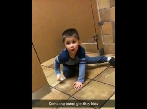 'What's your name?' Little boy crawls under stranger's bathroom stall