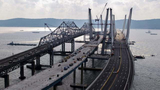 FILE -- The north span of the new Tappan Zee Bridge, with the old bridge at left, in Tarrytown, N.Y., Aug. 22, 2017. Recycled parts from the old bridge will go to a New York state artificial reef program to increase marine life and support recreation and economic development on Long Island. (Chang W. Lee/The New York Times)