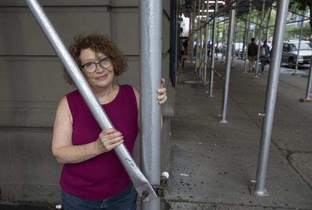 Lori Gold stands in front of a Columbia University building that has been cited for its cracked building facade, in New York, May 31, 2018. Gold's sister was killed by a piece of the building falling onto her as she walked by Columbia University campus in 1979, and Gold has been a tireless advocate for safety and scaffolding laws in her name ever since. (James Estrin/The New York Times)