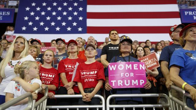 """Supporters cheer President Donald Trump during a campaign rally in Duluth, Minn., June 20, 2018. Many Trump voters recount undergoing something akin to a bonding experience with the president that happens each time they have to answer a now-familiar question: """"How can you possibly still support this man?"""" (Tom Brenner/The New York Times)"""
