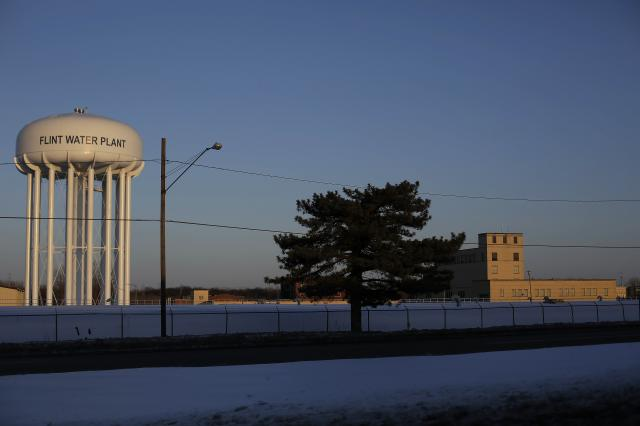 FILE -- The water tower and water plant in Flint, Mich., March 5, 2015. An inspector general's report found that the Environmental Protection Agency's response to Flint was hobbled by delays and poor coordination between state and federal officials. (Joshua Lott/The New York Times)