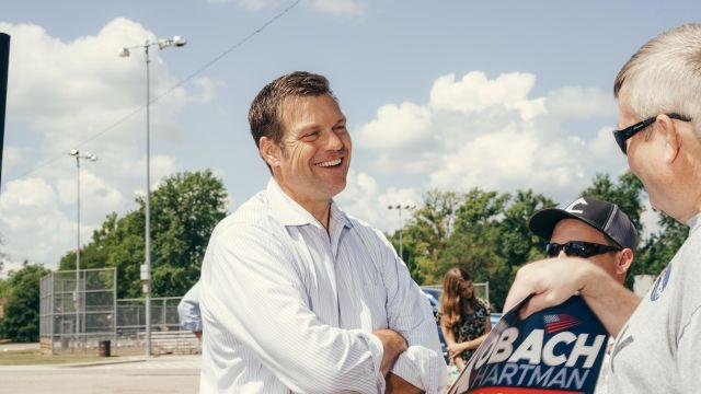 Kris Kobach, the Kansas Secretary of State and a Republican candidate for governor, speaks with supporters at a rally in Manhattan, Kan., July 31, 2018. President Donald Trump turned aside the advice of party officials and intervened in the Kansas Republican primary for governor by throwing his support behind Kobach, one day before voters go to the polls there. (Barrett Emke/The New York Times)