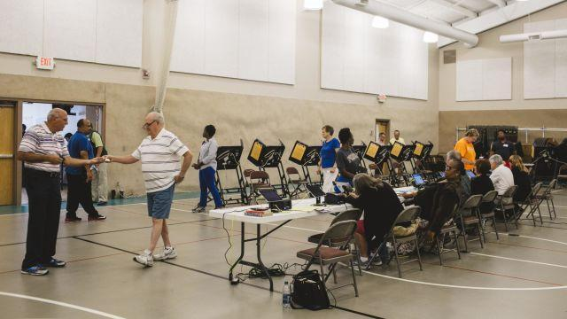 Voters in a polling station at Quest Community Church in Westerville, Ohio, Aug. 7, 2018. Voters in Ohio's 12th District will choose a replacement for Rep. Pat Tiberi, a Republican who resigned to work for a business group. The candidates are Troy Balderson, a Republican endorsed last week by President Donald Trump, and Danny O'Connor, a Democrat. (Andrew Spear/The New York Times)
