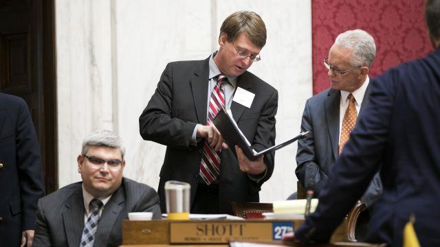 Counsel Robert Akers, center, looks over paperwork with Delegate John Shott, right, a Republican, before the House of Delegates convened for an impeachment hearing at the State Capitol in Charleston, W.Va., Aug. 13, 2018. Members voted to impeach state Supreme Court justices accused in a spending scandal on Monday. (Maddie McGarvey/The New York Times)