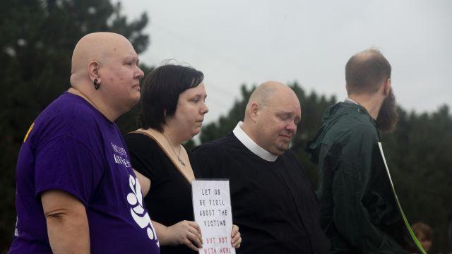 From left: the Rev. Cei Loofe, Catherine Baker-Coleman, the Rev. Royal Carleton, and Matthew Rehwaldt stand in silent protest outside the Nebraska State Penitentiary in Lincoln on the morning of Carey Dean Moore's planned execution, Aug. 14, 2018. Moore was executed here Tuesday morning, Nebraska's first execution since 1997 and the first in the United States carried out using fentanyl, the powerful opioid at the center of the nation's overdose epidemic. (Luke Franke/The New York Times)
