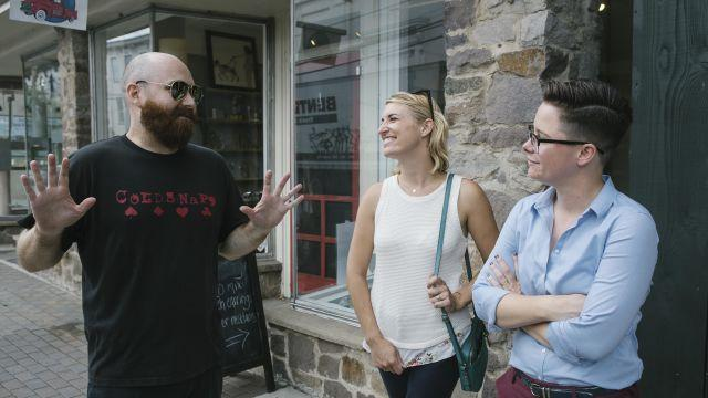 """Julia Fahl, right, and her wife, Kari Osmond, with Henry Ahern, a friend and supporter, in Lambertville, N.J., Aug. 2, 2018. Fahl defeated an incumbent in the primary race for mayor of Lambertville, who had been in office since the year Fahl was born. """"I don't want to be mayor in 20 years. But I did make a commitment to get some serious stuff done,"""" she said. (Michelle Gustafson/The New York Times)"""