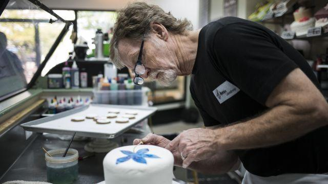 FILE -- Jack Phillips, the owner of Masterpiece Cakeshop, at work in his store in Lakewood, Colo., Aug. 24, 2017. Phillips, who won a Supreme Court case in 2018 after refusing to make a cake for a same-sex wedding, has sued the governor of Colorado, alleging the state discriminated against him when he declined to make a blue and pink cake for a transgender woman. (Nick Cote/The New York Times)