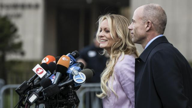 FILE-- Stephanie Clifford, the porn star better known as Stormy Daniels, speaks to reporters outside a federal courthouse after a hearing involving Michael Cohen, President Donald Trump's longtime personal lawyer, in New York, April 16, 2018. Coordinating with Michael Cohen, a tabloid giant turned its tip line into a trip wire for negative stories that could hurt the Trump campaign, prosecutors said. (Jeenah Moon/The New York Times)