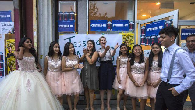 FILE -- Cynthia Nixon and Jessica Ramos, who is running for state Senate, with youths who gathered for a Sweet 16 party in Jackson Heights, Queens, Aug. 10, 2018. Polls show Nixon trailing far behind Gov. Andrew Cuomo. But her campaign insists she's reaching a new electorate not captured by the old metrics. (Hiroko Masuike/The New York Times)