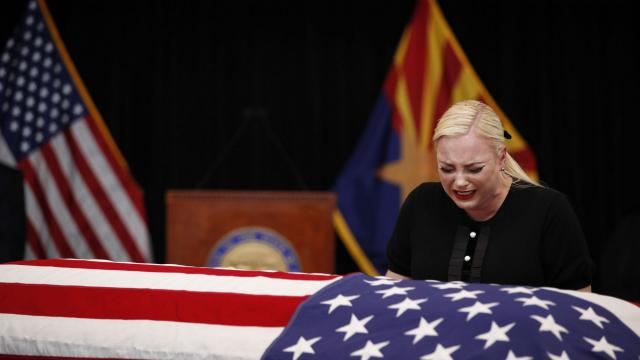 Meghan McCain, daughter of the late Sen. John McCain, cries over her father's coffin during his memorial service in the museum rotunda at the State Capitol in Phoenix, Aug. 29, 2018. Arizonans began to say farewell here on Wednesday morning to McCain, the towering political figure in this part of the West who died over the weekend at age 81, with his constituents and family honoring him as he lies in state at the capitol. (Jae C. Hong/Pool via The New York Times) -- FOR EDITORIAL USE ONLY. --