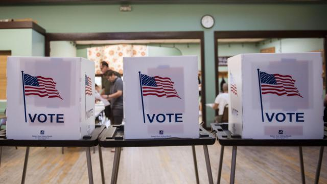 FILE -- A polling station in Madison, Wis., Aug. 14, 2018. Amid a chorus of warnings that the American election system is ground zero for foreign attackers, a panel of leading scholars and election experts issued a sweeping set of recommendations on Sept. 6, 2018, for how to make elections more secure. (Lauren Justice/The New York Times)