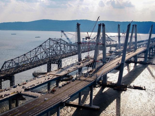 """FILE -- The Tappan Zee Bridge, far left, and the Mario M. Cuomo Bridge, in Tarrytown, N.Y., Aug. 22, 2017. While the first span of the Cuomo opened last year, Saturday's scheduled opening of the second span was delayed after a piece of the Tappan Zee became destabilized and threatened to fall, officials said, posing a """"potentially dangerous situation."""" (Chang W. Lee/The New York Times)"""