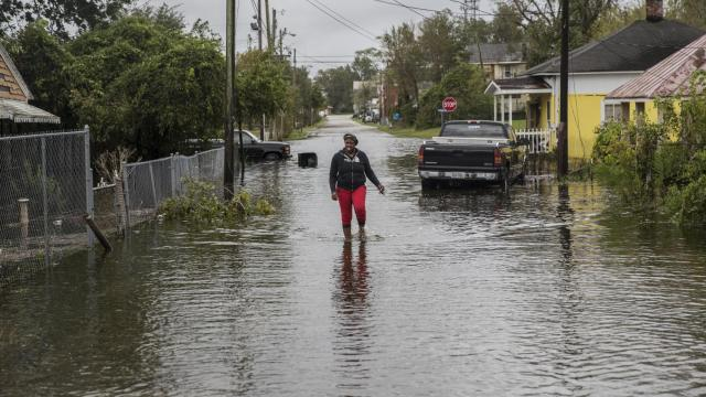 A resident in the flooded Duffyfield neighborhood of New Bern, N.C., the day after Hurricane Florence struck, Sept. 15, 2018. Florence continued its torrential roll through the Carolinas on Saturday; some cities have already seen 30 inches of rain, with more to come. At least five people have died. (Victor J. Blue/The New York Times)