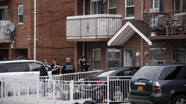 Police officers at the scene of a stabbing at a residential day care center in the Flushing section of Queens, Sept. 21, 2018. Three infants, including a 3-day-old child, and two adults were in critical but stable condition after being stabbed at the facility by an employee who then cut her own wrist, the police said. (Karsten Moran/The New York Times)