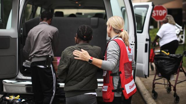 Eve Edwards, left, a Hurricane Florence evacuee, gets support from Red Cross volunteer Sheila Elliot, in Chapel Hill, N.C., Sept. 25, 2018. The storm's prodigious rainfall continues to swell rivers in the Carolinas, leaving evacuees stuck in shelters and driving more people from their homes. (Travis Dove/The New York Times)