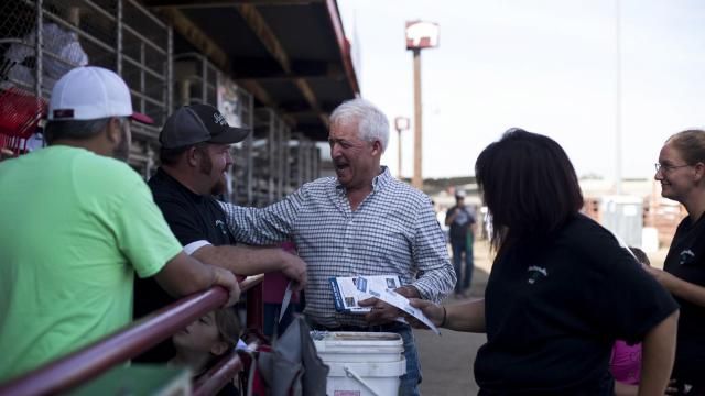 John Cox, California's Republican gubernatorial candidate, laughs as he talks to fairgoers at the Kern County Fair in Bakersfield, Calif., Sept. 27, 2018. Behind in the polls and fund-raising, Cox is vying for name recognition in a bus tour of the state. (Jenna Schoenefeld/The New York Times)