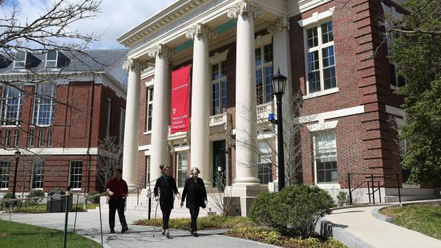 FILE -- Pedestrians stroll by the visitors center and admissions building at Harvard University in Cambridge, Mass., May 1, 2018. At a time of deepening racial and political divisions among Americans, a trial widely perceived to be a referendum on affirmative action will begin in Boston, bringing into a courtroom decades of fierce disputes over whether Harvard University and other elite institutions use racial balancing to shape their classes. (Hadley Green/The New York Times)