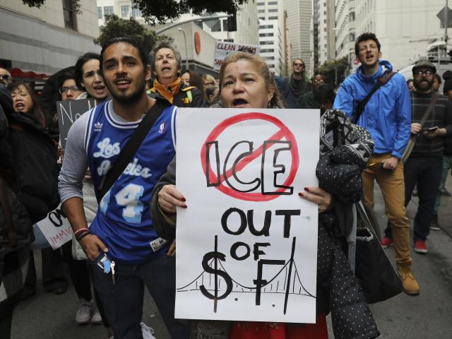 FILE -- Protesters demonstrate outside the Immigration and Customs Enforcement office in San Francisco, a so-called sanctuary city that provides little to no assistance to ICE, Feb. 28, 2018. As a tight battle for control of Congress enters its closing weeks, Democrats have found that in politically competitive states, particularly ones that President Trump carried in 2016, political attacks on immigration can easily turn crucial voting blocs against Democrats. (Jim Wilson/The New York Times)