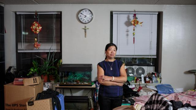 Po Kan Lo in her apartment at the Thelma Burdick building on Manhattan's Lower East Side, Oct. 15, 2018. For 30 years, the backyard behind the Thelma Burdick building on Manhattan's Lower East Side was an oasis of open space for the low-income tenants who lived there. Now, it's a 28-story boutique hotel. (Sarah Blesener/The New York Times)