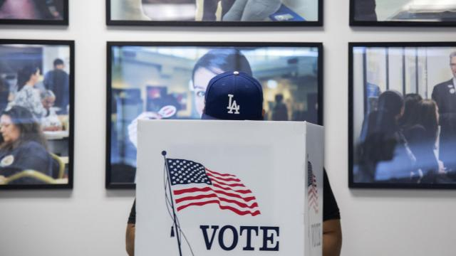 FILE — Ricky Diaz fills out a primary ballot in Los Angeles, June 4, 2018. Even with millions of Latinos becoming newly eligible to vote every election cycle, many fail to cast ballots. Whether Latinos will turn out in large numbers this midterm election — this time with party control in Washington at stake — remains a big question. (Melissa Lyttle/The New York Times)