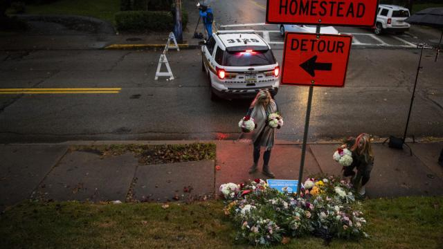Adrienne Wager, left, and Shannon Haldeman place flowers near the Tree of Life Congregation, a day after 11 people died at the synagogue during a shooting rampage, in Pittsburgh, Oct. 28, 2018. Authorities on Sunday identified the 11 victims of the shooting in which a man armed with an AR-15-style assault rifle and three handguns shot into a morning worship service in the deadliest attack against the Jewish community in the United States in decades. (Michael Henninger/The New York Times)