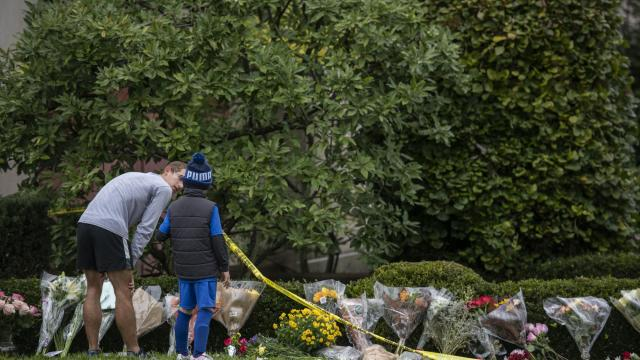 Flowers are left on the grounds of the Tree of Life Congregation in Pittsburgh, where 11 people were killed in a mass shooting Saturday, Oct. 28, 2018. HIAS, a Jewish refugee resettlement agency, is the target of many anti-Semitic rants posted on social media by Robert Bowers, the suspect in the shooting. (Michael Henninger/The New York Times)