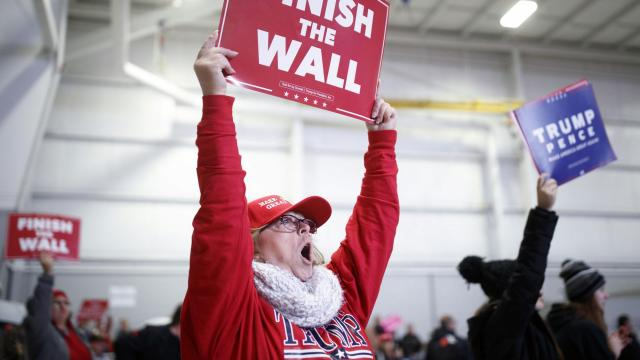 A supporter of President Donald Trump holds a sign as the president speaks at a rally in Mosinee, Wisc., on Wednesday, Oct. 24, 2018. Trump is trying to draw the attention of Republican voters back to issues like immigration, which have always sparked enthusiasm among the Republican grassroots. (Tom Brenner/The New York Times)