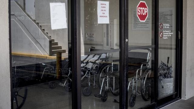 FILE-- A sign on the door of the now-closed emergency room at Twin Rivers Regional Medical Center, in Kennett, Mo., June 17, 2018. Beyond the potential health consequences for the people living nearby, hospital closings can exact an economic toll, and are associated with some states' decisions not to expand Medicaid as part of the Affordable Care Act. (Amy Stroth/The New York Times)