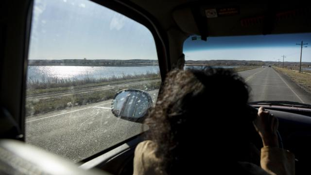 Phyllis Young, a longtime tribal activist leading voter-outreach efforts, drives on the Standing Rock Indian Reservation in Fort Yates, N.D., Oct. 22, 2018. Under a new law, North Dakotans cannot vote without a residential address; Native Americans, who largely rely on post office boxes, are working to overcome what they see as a clear attempt at voter suppression. (Kristina Barker/The New York Times)