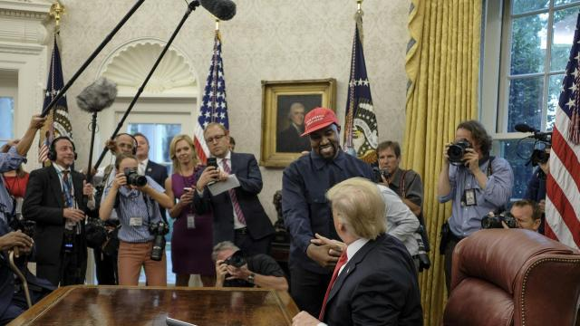 "FILE-- Kanye West greets President Donald Trump in the Oval Office of the White House, in Washington, Oct. 11, 2018. West, the rapper who became a hero of some conservatives by forcefully supporting Trump, tweeted on Oct. 30 that he had been ""used to spread messages I don't believe in"" and pledged to stay away from politics. (Gabriella Demczuk/The New York Times)"