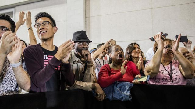 People watch Barack Obama speak during a rally in Las Vegas, Oct. 22, 2018. While Obama's speeches this election cycle have largely stuck with his trademark themes of idealism and hope, some of his supporters wonder if they're witnessing a living time capsule from a bygone era of civil political rhetoric. (Joe Buglewicz/The New York Times)