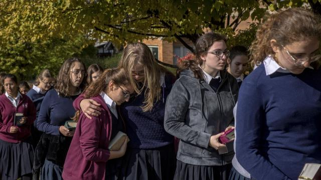 Students from Yeshiva Girls School attend the funeral for Joyce Fienberg, a researcher at the University of Pittsburgh who was one of the 11 victims of the shooting at Tree of Life Congregation, at Beth Shalom Synagogue in Pittsburgh, Oct. 31, 2018. A federal grand jury indicted the man accused of carrying out the attack on 44 counts, including hate crimes, prosecutors said. (Hilary Swift/The New York Times)