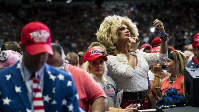Elaine Lancaster puts her makeup on as she waits for President Donald Trump to speak at a campaign rally in Fort Myers, Fla., Oct. 31, 2018. (Doug Mills/The New York Times)