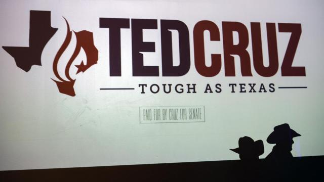 The silhouettes of two supporters of Sen. Ted Cruz (R-Texas) are cast on a screen before the start of a re-election campaign event in Fort Worth, Texas, on Friday, Nov. 2, 2018. (Tamir Kalifa/The New York Times)