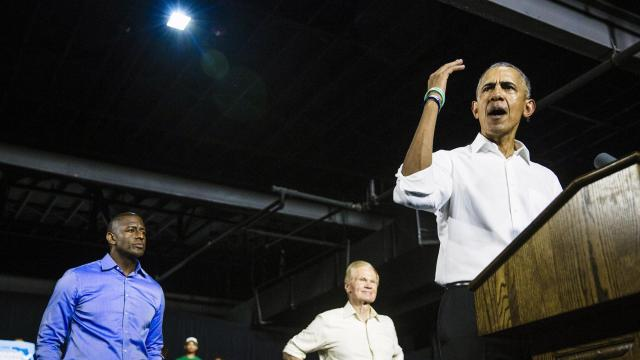 Former President Barack Obama stumps for Democratic gubernatorial candidate Andrew Gillum, left, and Sen. Bill Nelson (D-Fla.) at a rally in Miami on Friday, Nov. 2, 2018. As he hits the campaign trail this fall, Obama is assailing his successor in a sharper, more systematic way than any former president has done in three-quarters of a century. (Scott McIntyre/The New York Times)