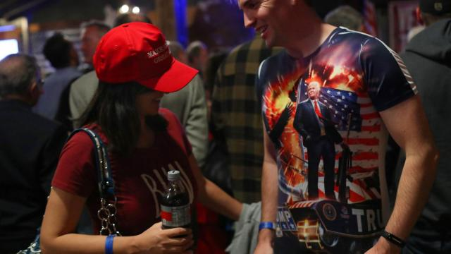 Rallygoers show off clothing in support of President Donald Trump during a rally for Danny Tarkanian, a Republican candidate for Nevada's 3rd Congressional District, at Stoney's Rockin' Country in Las Vegas, Nov. 2, 2018. (Jim Wilson/The New York Times)