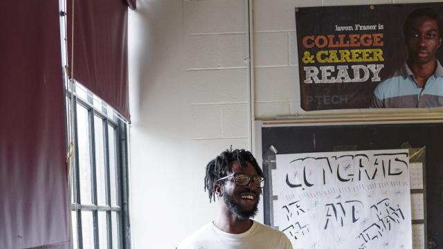 Chigozie Okorie, a recent graduate from Pathways in Technology Early College High School, or P-Tech, who helps run its mentoring program, in New York, Oct. 4, 2018. P-Tech is a six-year program that gives students from lower-income backgrounds the chance to earn a high school diploma along with a cost-free associate degree in a STEM field. (Sarah Blesener/The New York Times)