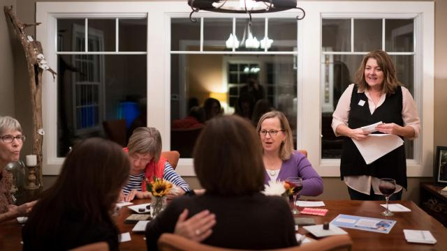 "Margo Williams talks with other women writing postcards as Christine Matthews, top right, looks on during a postcard writing party in support of Abigail Spanberger, a Democrat running for Congress, at Matthews' home in Alexandria, Va., Oct. 23, 2018. A surge in activism has redefined ""women's issues"" and deepened the gender divide between the parties. (Erin Schaff/The New York Times)"