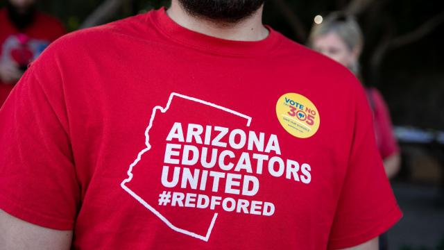 Attendees at the Arizona Education Association's statewide day of action, where Rep. Kyrsten Sinema spoke, in Phoenix, Nov. 3, 2018. (Ilana Panich-Linsman/The New York Times)