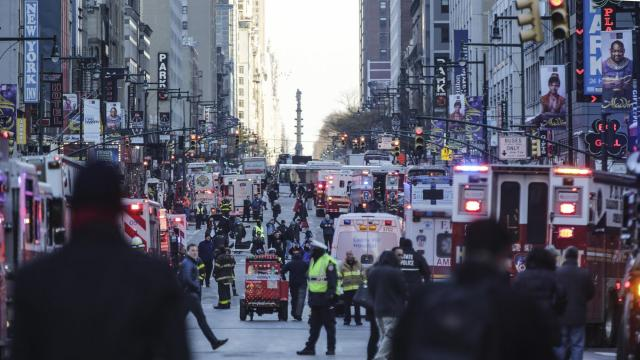 FILE-- New York City police and firefighters near the Port Authority Bus Terminal in Manhattan following a pipe bomb explosion in New York, Dec. 11, 2017. Akayed Ullah, a Bangladeshi immigrant who was said to be inspired by the Islamic State, was found guilty of federal terrorism charges on Nov. 6, 2018, for detonating the bomb in a crowded subway corridor near Times Square. (Jeenah Moon/The New York Times)