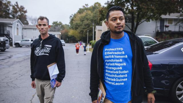 Jose De Jesus Esparza Morales and Ivan Vargas canvass for Mijente, in support of Stacey Abrams, the Democratic candidate for governor, in Smyrna, Ga., Nov. 5, 2018. (Audra Melton/The New York Times)