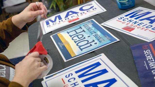 Supporters prepare campaign signs for Democratic candidates, including Sen. Heidi Keitkamp (D-N.D.) and House hopeful Mac Schneider, at the AFL-CIO House of Labor in Bismarck, N.D., on Monday, Nov. 5, 2018. (Hilary Swift/The New York Times)